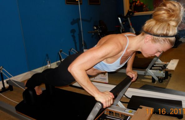 The Plank move on a pilates reformer offers arm-toning and full-body lengthening.