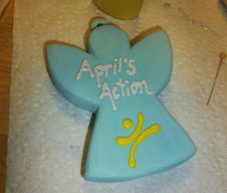 Aprils Action ornament. A symbol of April Kelly's legacy and giving back.