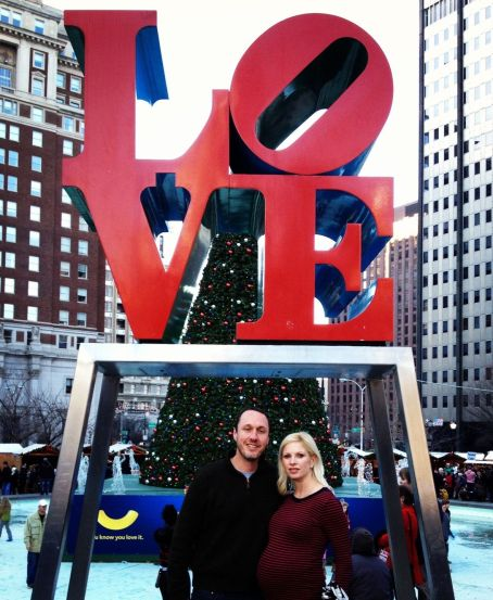 Chelsea Charles and Geoff Koch underneath the LOVE sculpture